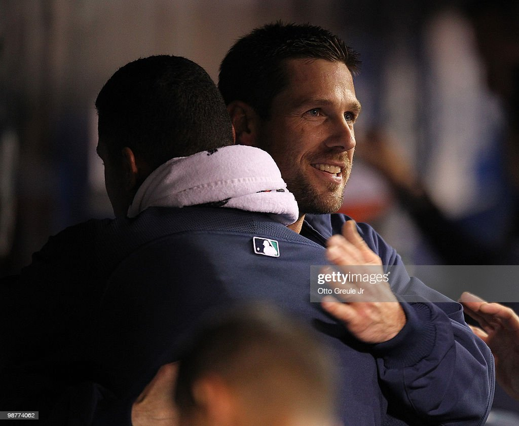 Starting pitcher Cliff Lee #36 (R) of the Seattle Mariners gets a hug from Felix Hernandez #34 after coming out of the game against the Texas Rangers at Safeco Field on April 30, 2010 in Seattle, Washington.
