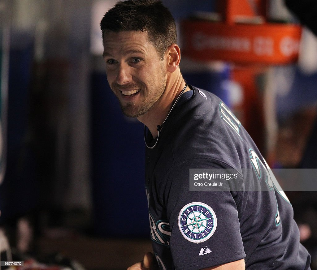 Starting pitcher Cliff Lee #36 (R) of the Seattle Mariners smiles in the dugout after coming out of the game against the Texas Rangers at Safeco Field on April 30, 2010 in Seattle, Washington.