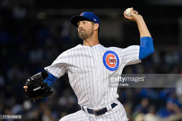Starting pitcher Cole Hamels of the Chicago Cubs delivers the ball in the first inning against the Cincinnati Reds at Wrigley Field on September 16...
