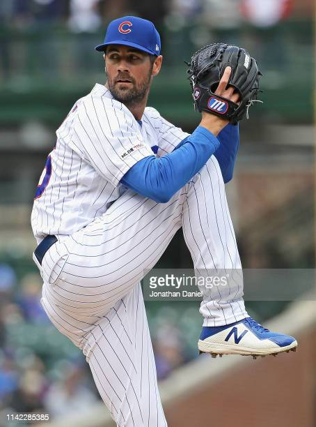 Starting pitcher Cole Hamels of the Chicago Cubs delivers the ball against the Los Angeles Angels at Wrigley Field on April 12 2019 in Chicago...