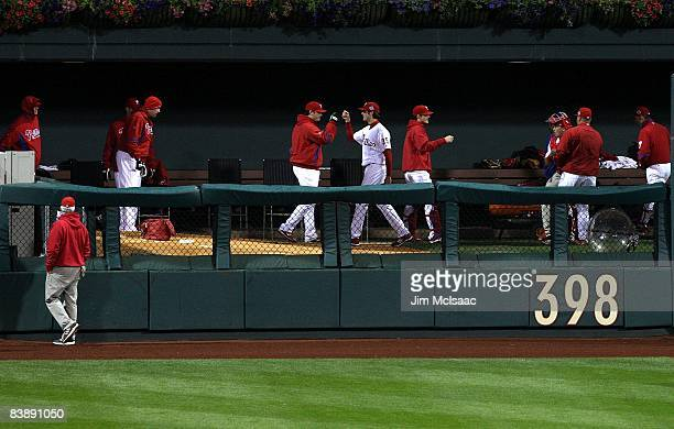 Starting pitcher Cole Hamels of the Philadelphia Phillies greets his teammates in the bullpen before walking out to pitch against the Tampa Bay Rays...