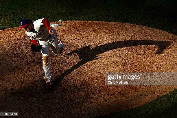 Starting pitcher Cole Hamels of the Philadelphia Phillies throws a pitch against the Colorado Rockies in Game Two of the NLDS during the 2009 MLB...