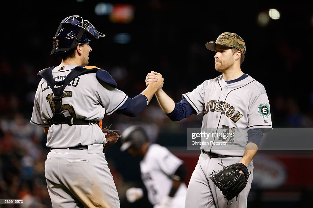 Starting pitcher Collin McHugh #31 of the Houston Astros celebrates with catcher Jason Castro #15 after defeating the Arizona Diamondbacks 8-3 in the MLB game at Chase Field on May 30, 2016 in Phoenix, Arizona.