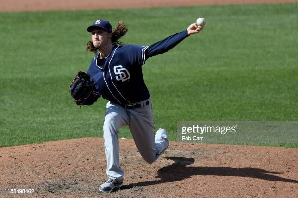 Starting pitcher Craig Stammen of the San Diego Padres throws to a Baltimore Orioles batter in the fourth inning at Oriole Park at Camden Yards on...