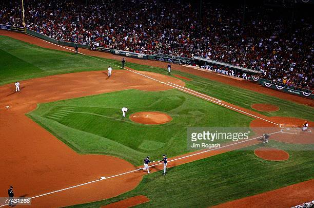 Starting pitcher Curt Schilling of the Boston Red Sox stands on the mound after giving up a solo home run to Victor Martinez of the Cleveland Indians...