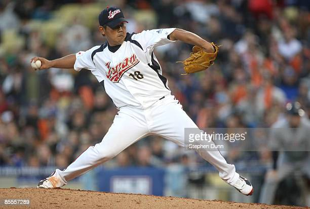 Starting pitcher Daisuke Matsuzaka of Japan delivers a pitch against the United States in the semifinal game of the 2009 World Baseball Classic...