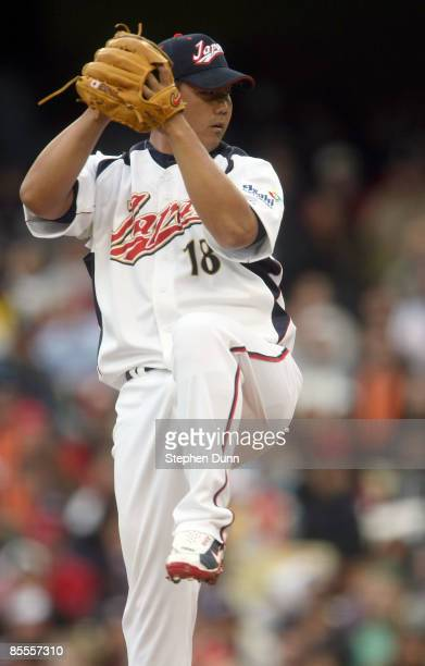 Starting pitcher Daisuke Matsuzaka of Japan delivers a pitch against the United States in the semifinal game of the 2009 World Baseball Classic on...