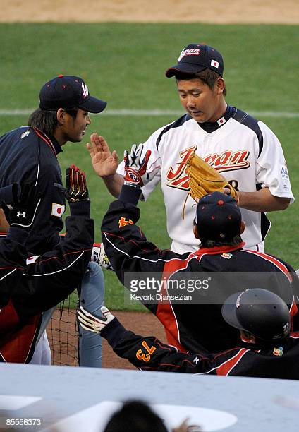 Starting pitcher Daisuke Matsuzaka of Japan returns to the dugout after being relieved in the fifth inning of the semifinal game of the 2009 World...