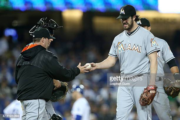 Starting pitcher Dan Haren of the Miami Marlins is relieved by manager Mike Redmond in the fifth inning against the Los Angeles Dodgers at Dodger...
