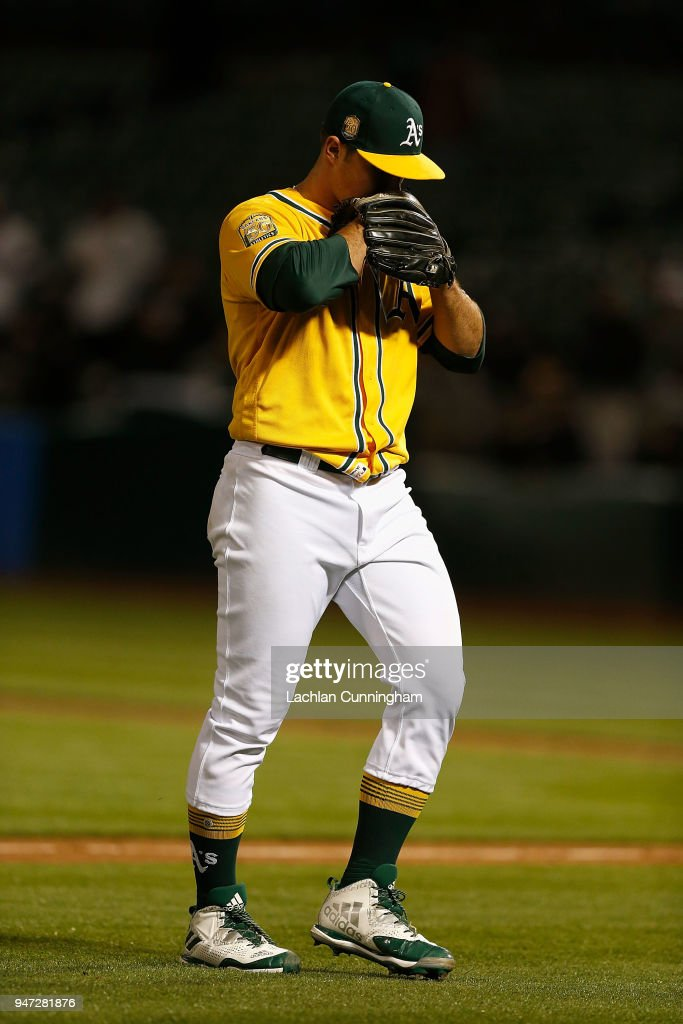 Starting pitcher Daniel Mengden #33 of the Oakland Athletics leaves the game against the Chicago White Sox in the ninth inning after giving up a solo home run at Oakland Alameda Coliseum on April 16, 2018 in Oakland, California.