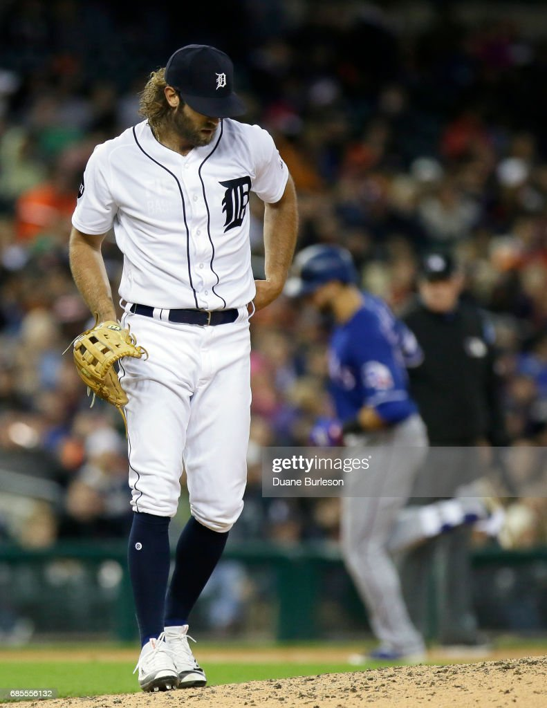 Starting pitcher Daniel Norris #44 of the Detroit Tigers walks back to the mound as Joey Gallo #13 of the Texas Rangers rounds the bases on a two-run home run during the sixth inning at Comerica Park on May 19, 2017 in Detroit, Michigan.