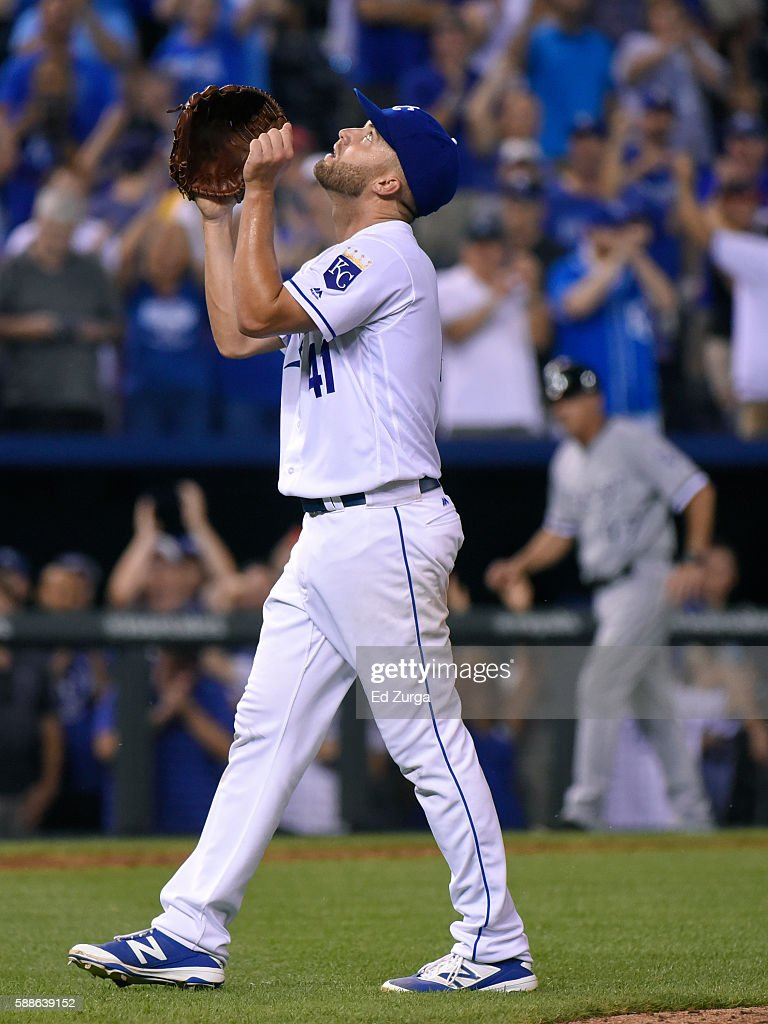 Starting pitcher Danny Duffy #41 of the Kansas City Royals celebrates after throwing a complete game against the Chicago White Sox at Kauffman Stadium on August 11, 2016 in Kansas City, Missouri. The Royals won 2-1.