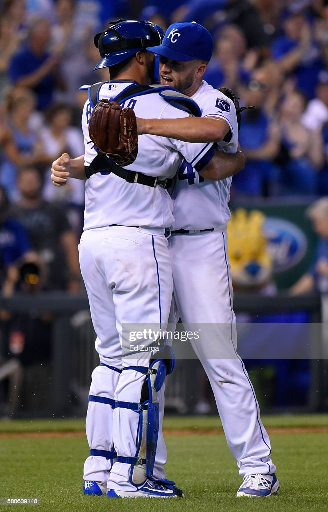 Starting pitcher Danny Duffy #41 of the Kansas City Royals celebrates his complete game with Drew Butera #9 of the Kansas City Royals during a game against the Chicago White Sox at Kauffman Stadium on August 11, 2016 in Kansas City, Missouri. The Royals won 2-1.