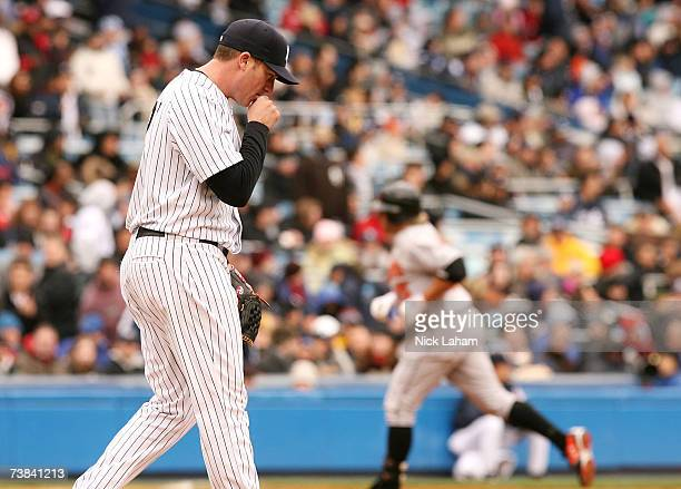 Starting pitcher Darrell Rasner of the New York Yankees walks back to the mound after Kevin Millar of the Baltimore Orioles hit a home run in the...