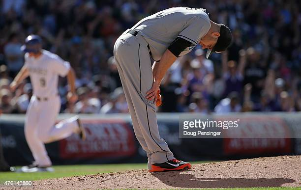 Starting pitcher David Phelps of the Miami Marlins reacts after giving up a three run home run to Carlos Gonzalez of the Colorado Rockies as DJ...