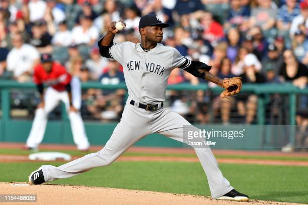 Starting pitcher Domingo German of the New York Yankees pitches during the first inning against the Cleveland Indians at Progressive Field on June 07...