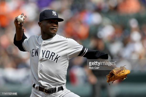 Starting pitcher Domingo German of the New York Yankees throws to a Baltimore Orioles batter at Oriole Park at Camden Yards on April 07 2019 in...