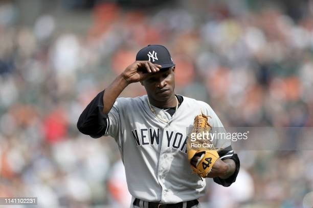 Starting pitcher Domingo German of the New York Yankees walks off the field against the Baltimore Orioles at Oriole Park at Camden Yards on April 07...