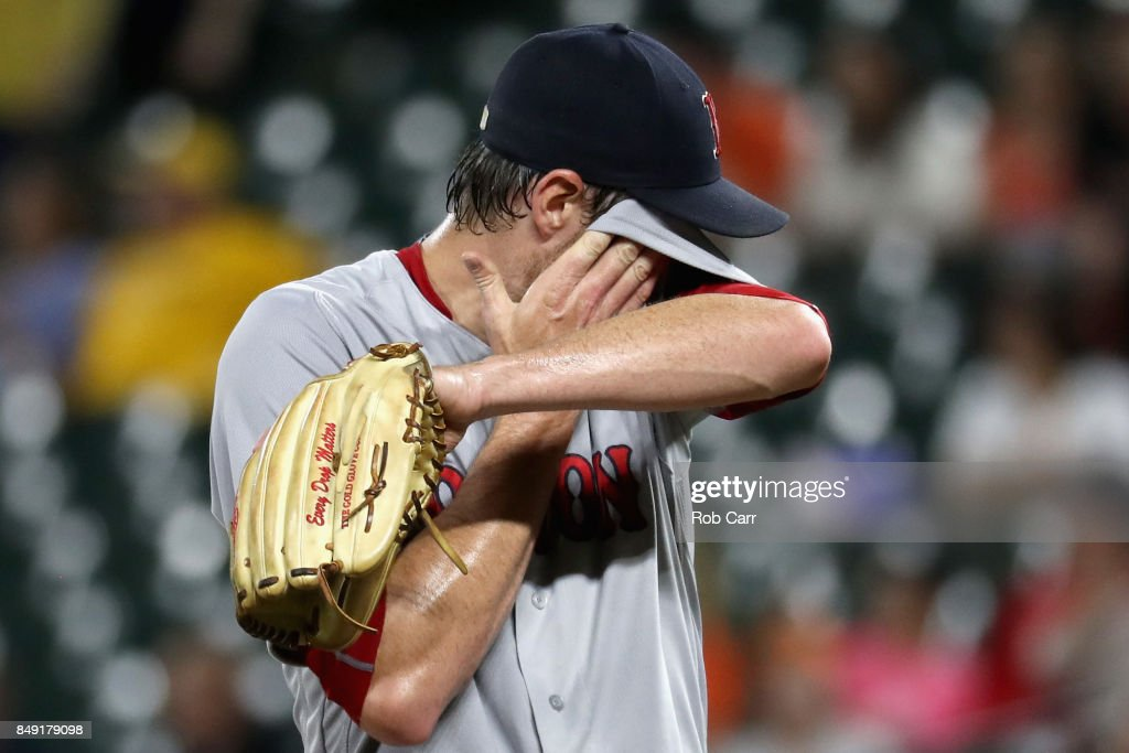 Starting pitcher Doug Fister #38 of the Boston Red Sox wipes his face on the mound after giving up two runs in the second inning against the Baltimore Orioles at Oriole Park at Camden Yards on September 18, 2017 in Baltimore, Maryland.