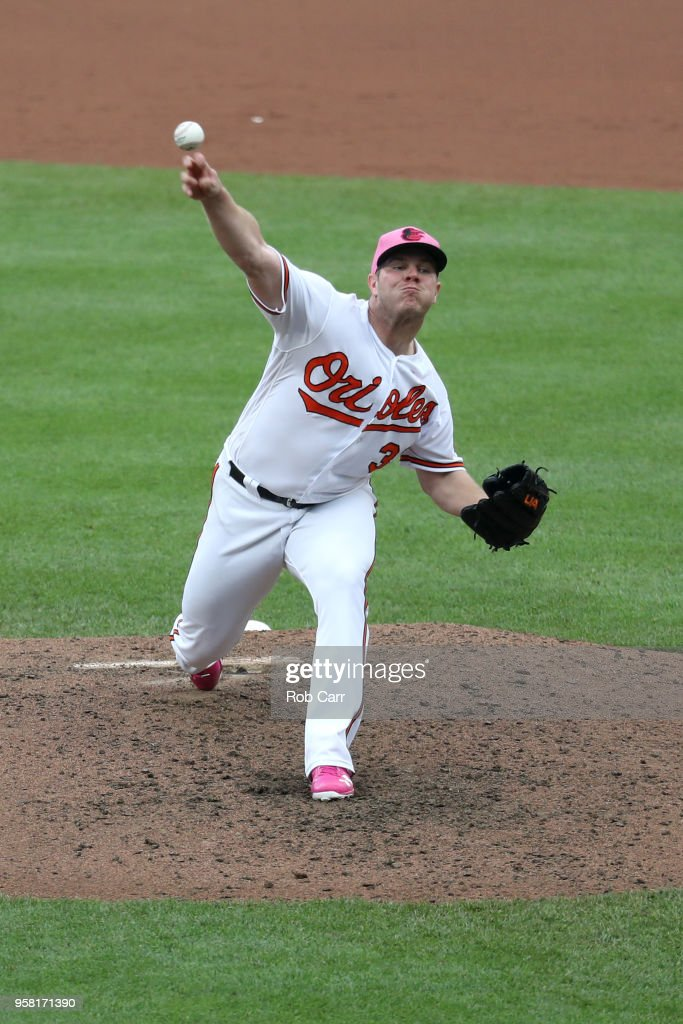 Starting pitcher Dylan Bundy #37 of the Baltimore Orioles throws to a Tampa Bay Rays batter in the fifth inning at Oriole Park at Camden Yards on May 13, 2018 in Baltimore, Maryland.
