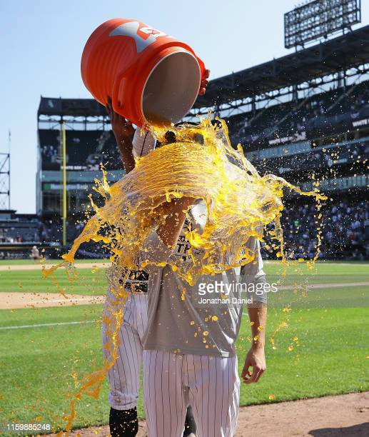 Starting pitcher Dylan Cease of the Chicago White Sox gets dunked by Eloy Jimenez after getting his first Major League win in his Major League debt...