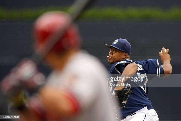 Starting pitcher Edinson Volquez of the San Diego Padres throws from the mound against the Arizona Diamondbacks to score a run during their MLB...