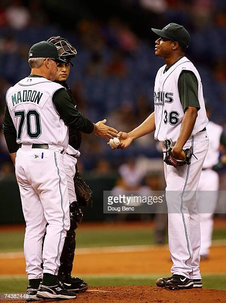 Starting pitcher Edwin Jackson of the Tampa Bay Devil Rays hands the ball to manager Joe Maddon while being pulled from the game in the fourth inning...