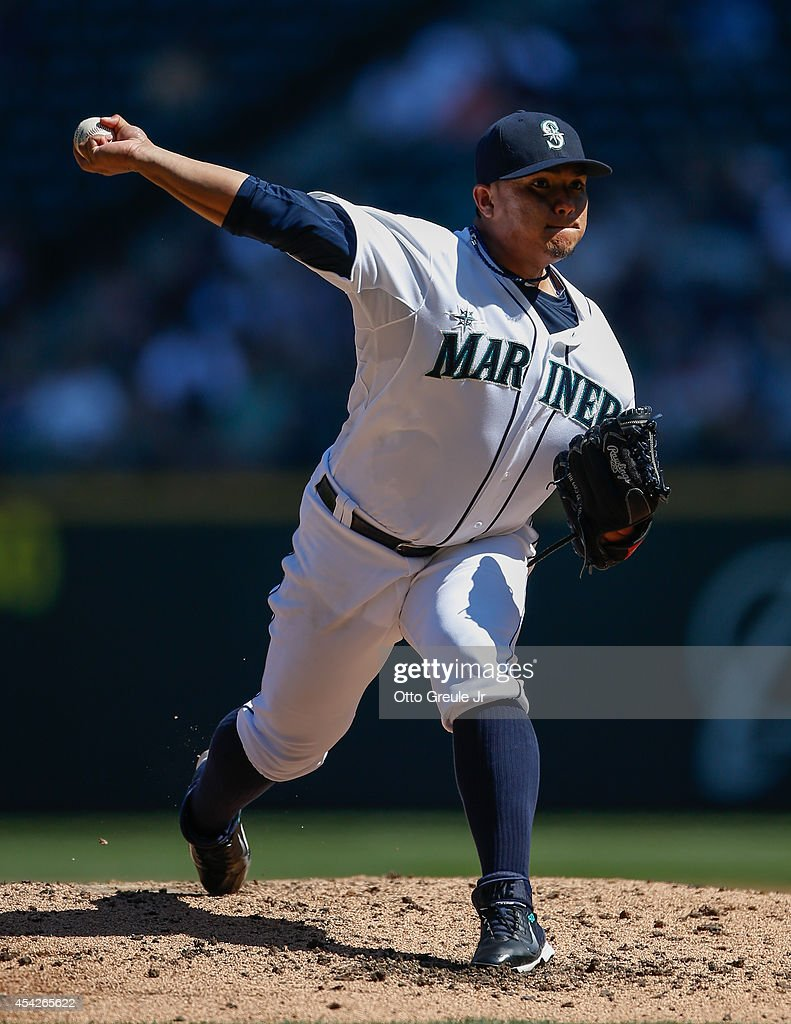 Starting pitcher Erasmo Ramirez #50 of the Seattle Mariners pitches in the third inning against the Texas Rangers at Safeco Field on August 27, 2014 in Seattle, Washington. The Rangers defeated the Mariners 12-4.