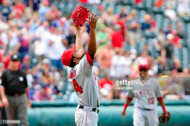 Starting pitcher Ervin Santana of the Los Angeles Angels throws up his arms in celebration after finishing a nohitter against the Cleveland Indians...