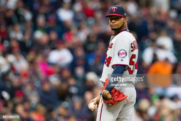 Starting pitcher Ervin Santana of the Minnesota Twins checks first after giving up a walk during the fourth inning against the Cleveland Indians at...