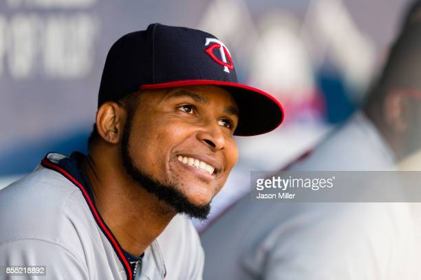 Starting pitcher Ervin Santana of the Minnesota Twins talks with teammates in the dugout during the fifth inning against the Minnesota Twins at...