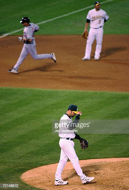Starting pitcher Esteban Loaiza of the Oakland Athletics reacts after giving up a two run home run to Alexis Gomez of the Detroit Tigers during the...