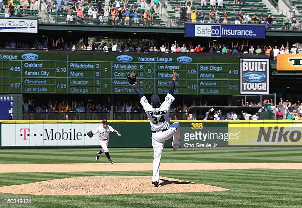 Starting pitcher Felix Hernandez of the Seattle Mariners and shortstop Brendan Ryan celebrate after Hernandez threw the 23rd perfect game in Major...