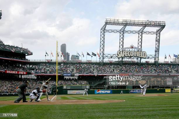 Starting Pitcher Felix Hernandez of the Seattle Mariners throws the first pitch of the game against Jason Kendall of the Oakland A's on opening day...