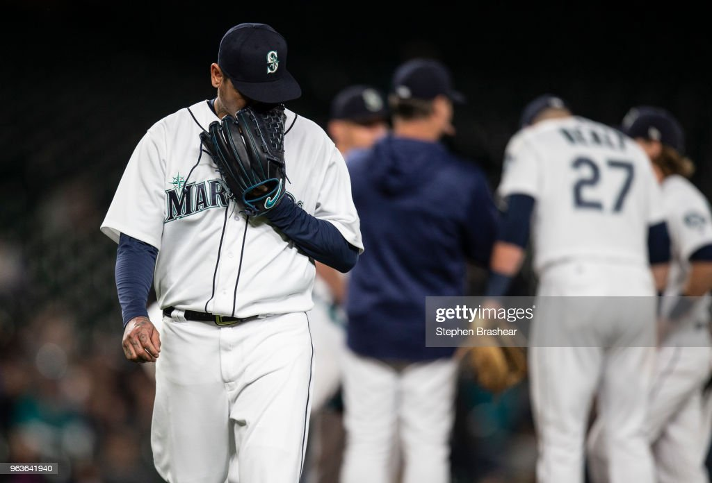 Starting pitcher Felix Hernandez #34 of the Seattle Mariners walks off the field after being pulled during the sixth inning of a game against the Texas Rangers at Safeco Field on May 29, 2018 in Seattle, Washington.