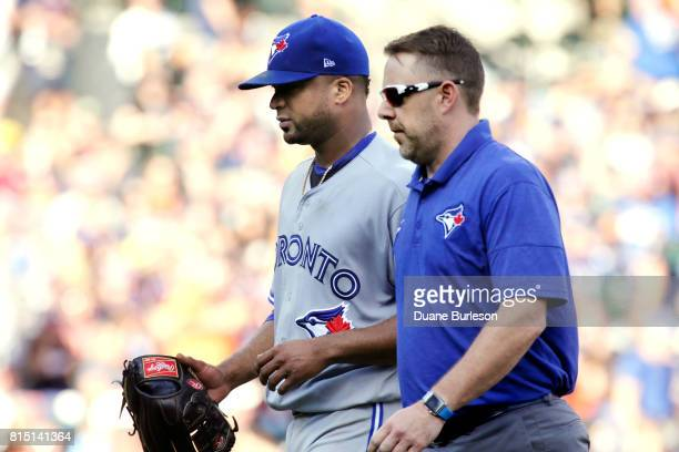 Starting pitcher Francisco Liriano of the Toronto Blue Jays leaves the game against the Detroit Tigers with a trainer during the third inning at...
