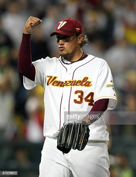 Starting pitcher Freddy Garcia of Venezuela celebrates after getting a strikeout to end a bases loaded one out rally by Italy in the top of the third...