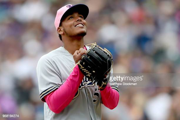 Starting pitcher Freddy Peralta of the Milwaukee Brewers walks to the dugout after being relieved in the sixth inning against the Colorado Rockies at...