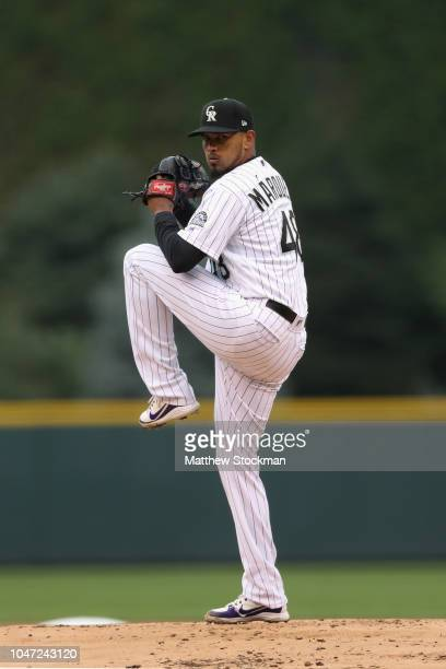 Starting pitcher German Marquez throws in the first inning of Game Three of the National League Division Series at Coors Field on October 7 2018 in...