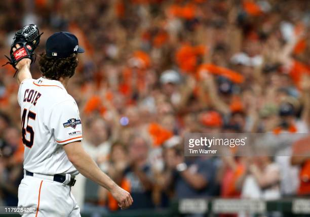 Starting pitcher Gerrit Cole of the Houston Astros acknowledges the crowd as he leaves the game in the eighth inning of Game 2 of the ALDS against...