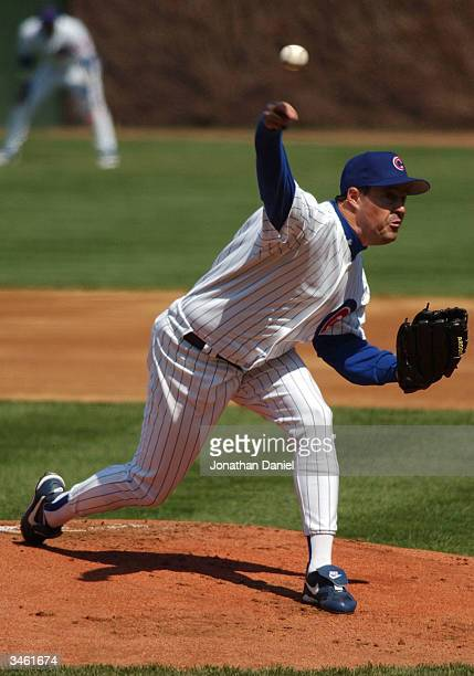 Starting pitcher Greg Maddux of the Chicago Cubs delivers the ball against the New York Mets during a game on April 23, 2004 at Wrigley Field in...