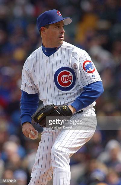 Starting pitcher Greg Maddux of the Chicago Cubs prepares to deliver the ball to the Pittsburgh Pirates on April 12, 2004 at Wrigley Field in...