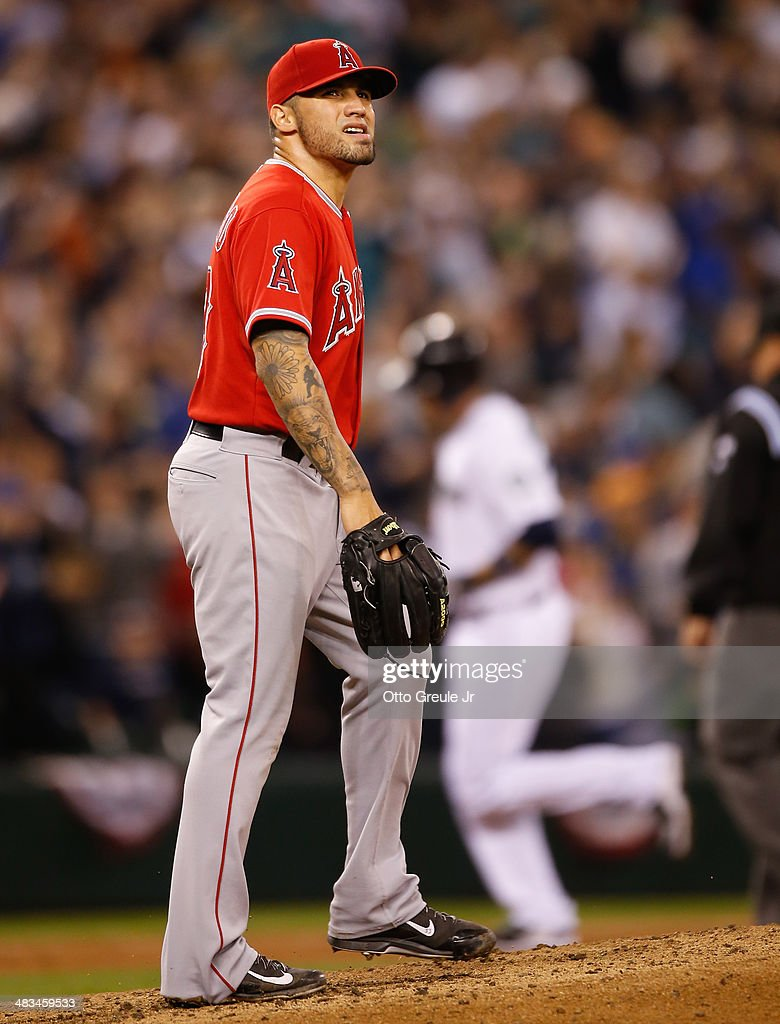 Starting pitcher Hector Santiago #53 of the Los Angeles Angels of Anaheim reacts after giving up a three-run homer to Corey Hart #27 of the Seattle Mariners in the third inning on Opening Day at Safeco Field on April 8, 2014 in Seattle, Washington.