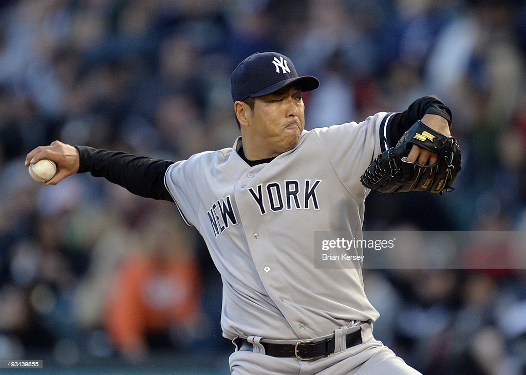 Starting pitcher Hiroki Kuroda #18 of the New York Yankees delivers a pitch during the third inning against the Chicago White Sox at U.S. Cellular Field on May 23, 2014 in Chicago, Illinois.