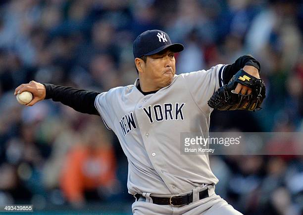Starting pitcher Hiroki Kuroda of the New York Yankees delivers a pitch during the third inning against the Chicago White Sox at US Cellular Field on...