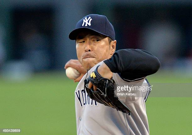 Starting pitcher Hiroki Kuroda of the New York Yankees delivers a pitch during the first inning against the Chicago White Sox at US Cellular Field on...