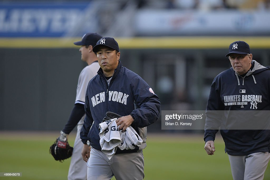 Starting pitcher Hiroki Kuroda #18 of the New York Yankees walks in from the bullpen before the game against the Chicago White Sox at U.S. Cellular Field on May 23, 2014 in Chicago, Illinois. The White Sox defeated the Yankees 6-5.
