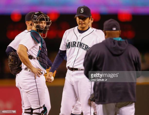 Starting pitcher Hisashi Iwakuma of the Seattle Mariners is removed from the game by manager Lloyd McClendon in the fifth inning against the Houston...