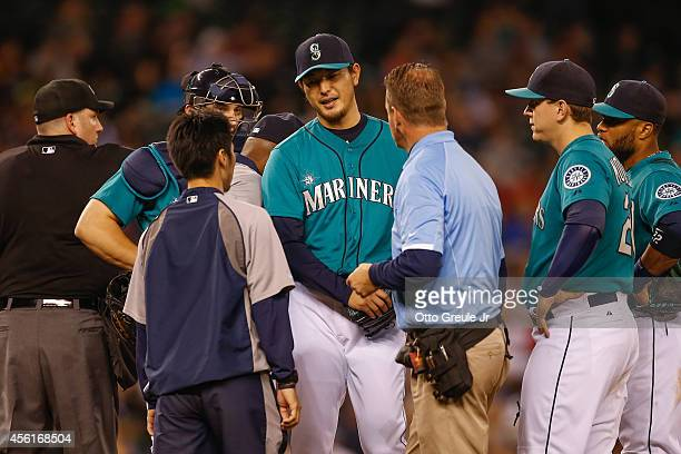 Starting pitcher Hisashi Iwakuma of the Seattle Mariners is removed from the game by manager Lloyd McClendon against the Los Angeles Angels of...