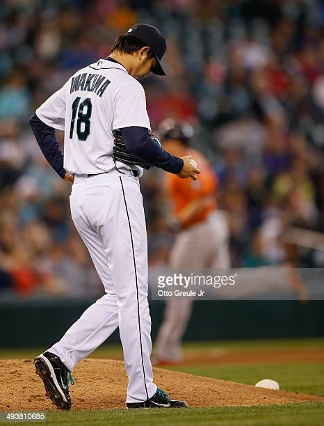 Starting pitcher Hisashi Iwakuma of the Seattle Mariners pauses on the mound after giving up a tworun homer to Marc Krauss of the Houston Astros in...